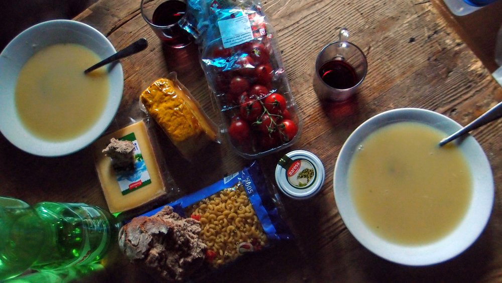 Our feast included soup, pasta with pesto, lots of cherry tomatoes, tofu for the vegetarian (ahem), and wine. Photo stolen from  Maarten Camerlynck .